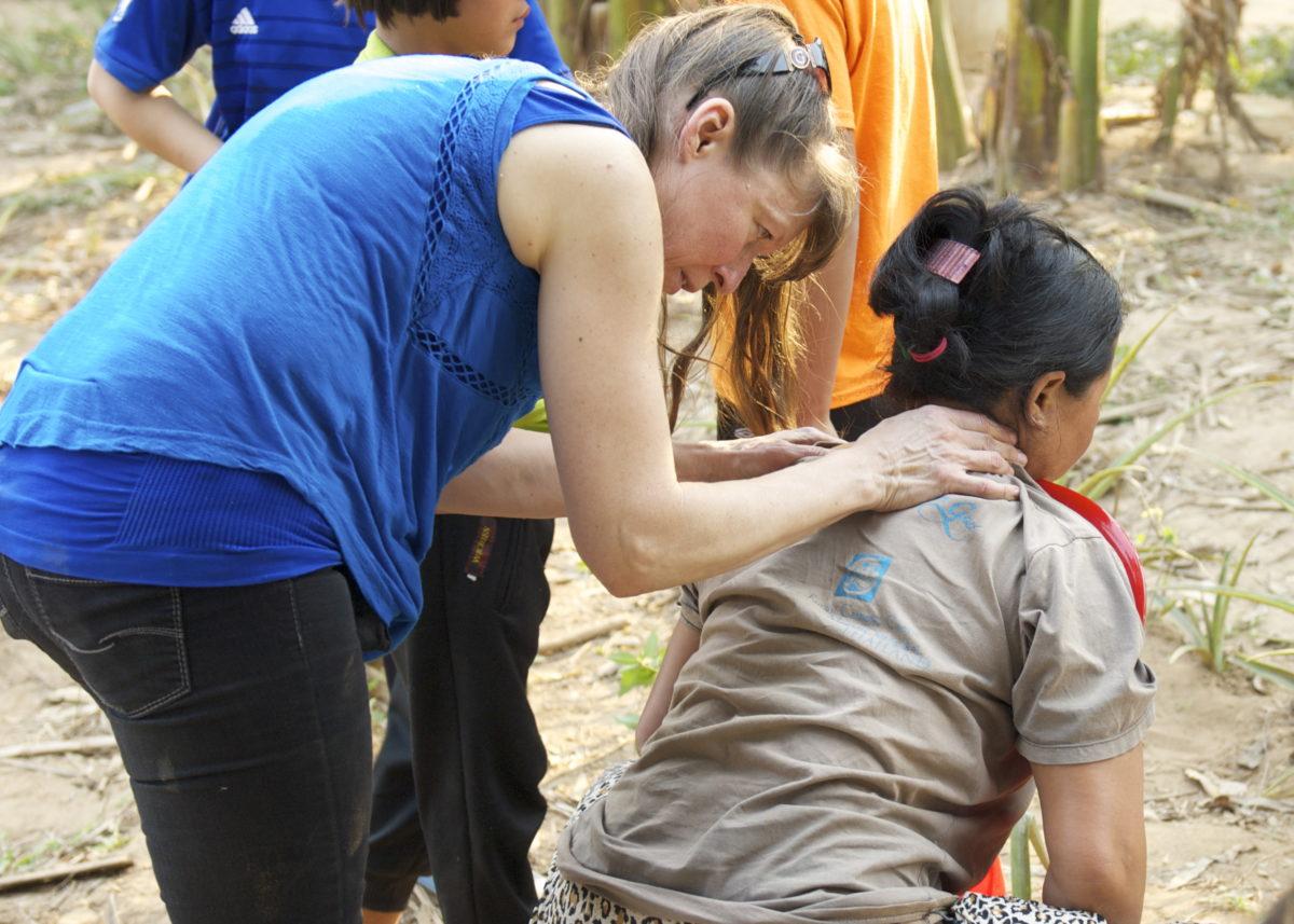 Judy massaging shoulders of sore labourer